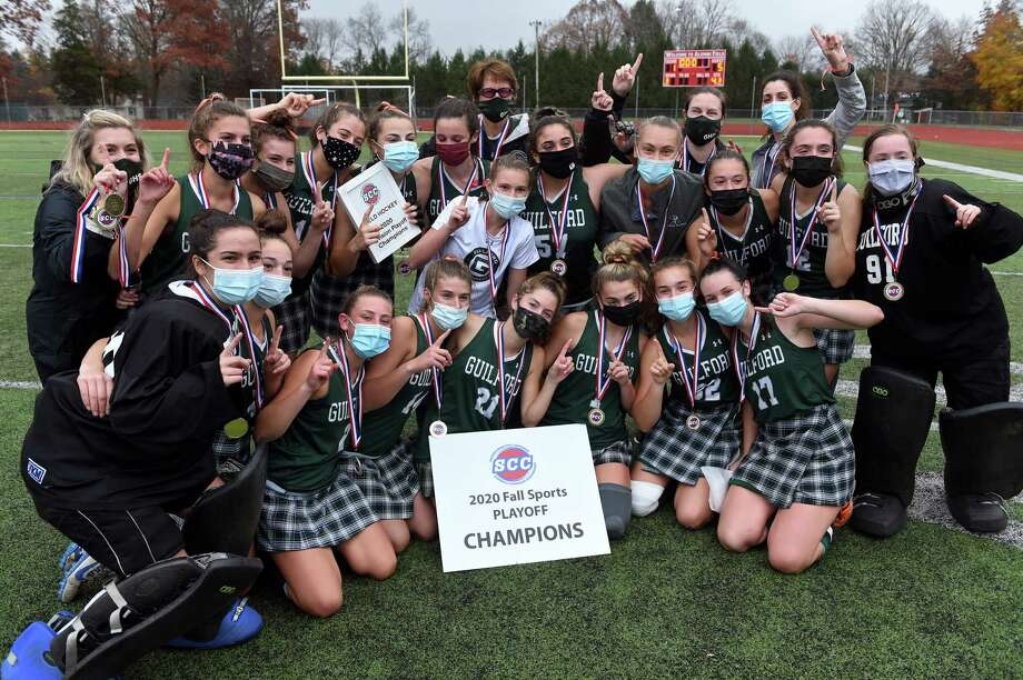 Guilford celebrates its 5-1 win over Cheshire in the SCC Division A field hockey championship at Cheshire High on Wednesday. Photo: Arnold Gold / Hearst Connecticut Media / New Haven Register