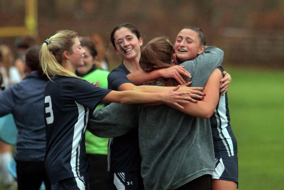 Lauralton Hall celebrates its win over Amity in the SCC Field Hockey Division B final in Woodbridge on Wednesday.