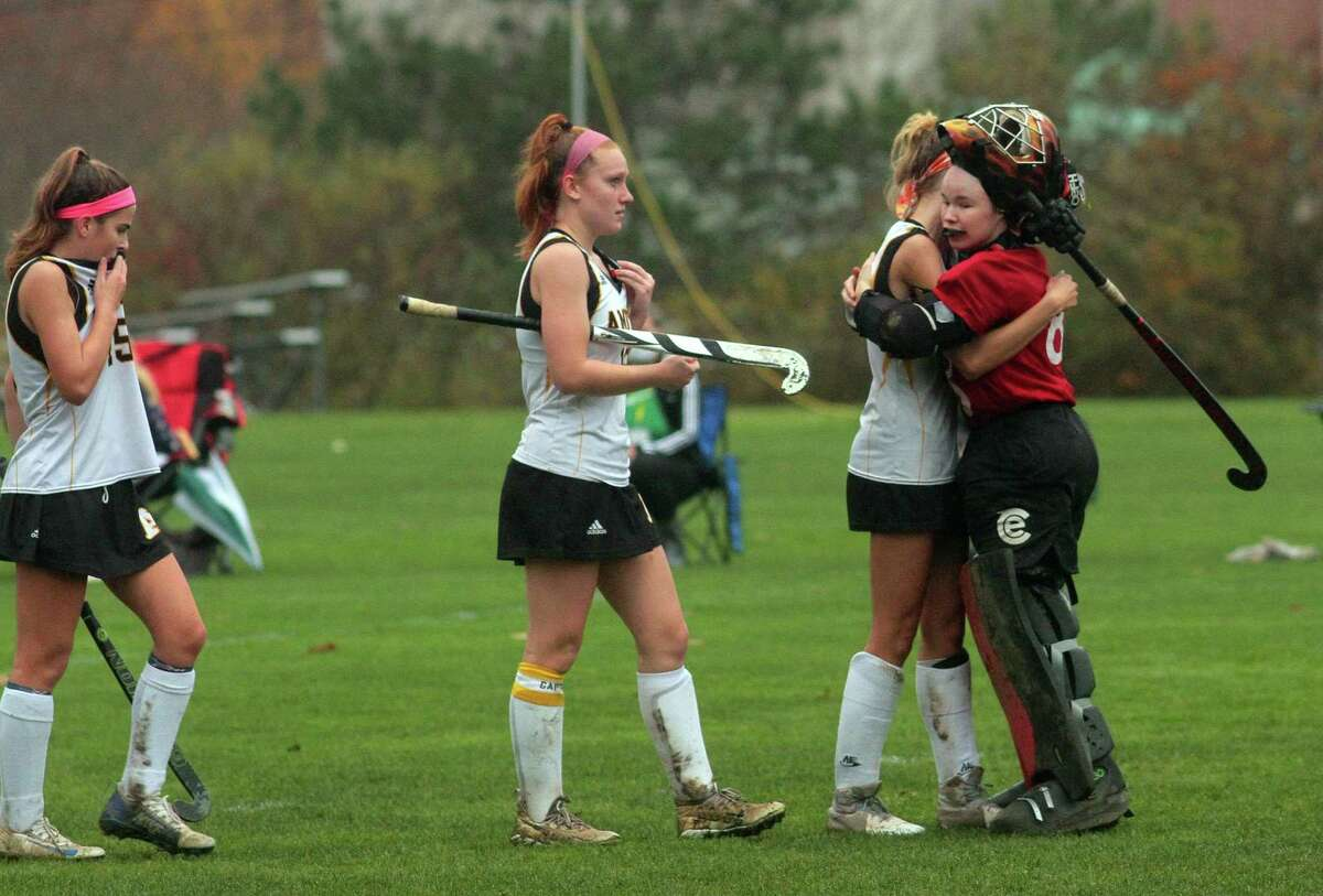 Amity players react after being defeated by Lauralton Hall in the SCC Field Hockey Division B final in Woodbridge on Wednesday.