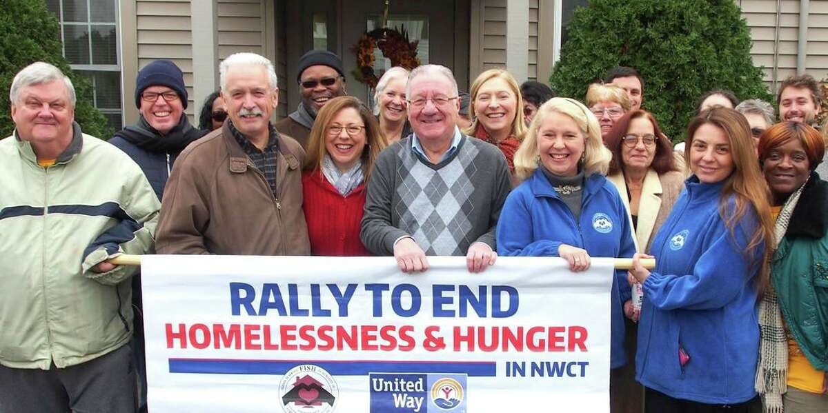 FISH of Northwest Connecticut, which provides food and shelter to Torrington-area residents, is holding its annual Rally to End Hunger and Homelessness by collecting winter coats for people in need. The rally's format has changed this year because of the pandemic. Above, supporters and members of FISH and the United Way attend the event in 2018.