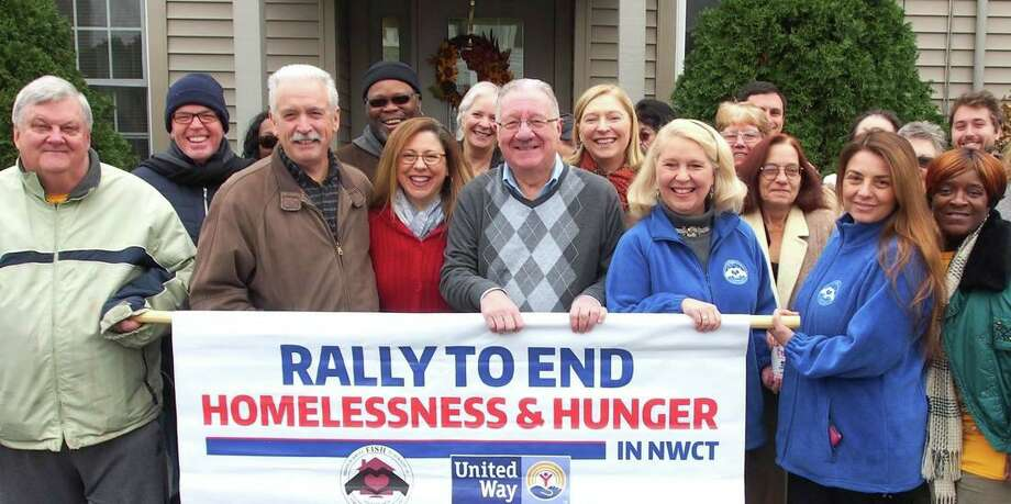 FISH of Northwest Connecticut, which provides food and shelter to Torrington-area residents, is holding its annual Rally to End Hunger and Homelessness by collecting winter coats for people in need. The rally's format has changed this year because of the pandemic. Above, supporters and members of FISH and the United Way attend the event in 2018. Photo: Contributed Photo /