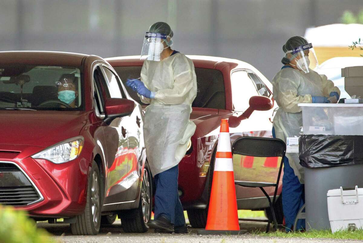 A person is tested for COVID-19 at the FITTEAM Ball Park of the Palm Beaches drive-through facility in West Palm Beach Thursday, Nov. 5, 2020. (Lannis Waters/The Palm Beach Post/TNS)