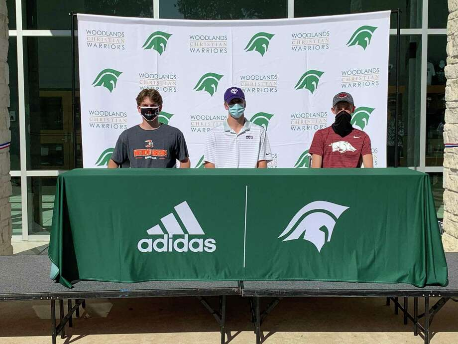 From left, Payton Moser, Caedmon Parker and Ben Shearer celebrated their college signings Wednesday. Photo: Jon Poorman