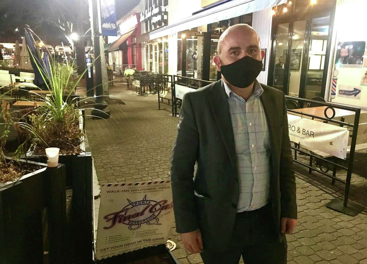 Ermal Caushi opened Division West in West Hartford three years ago and survived through coronavirus in part by creating a late-night menu. Now he's closed at 10 p.m., and worried.