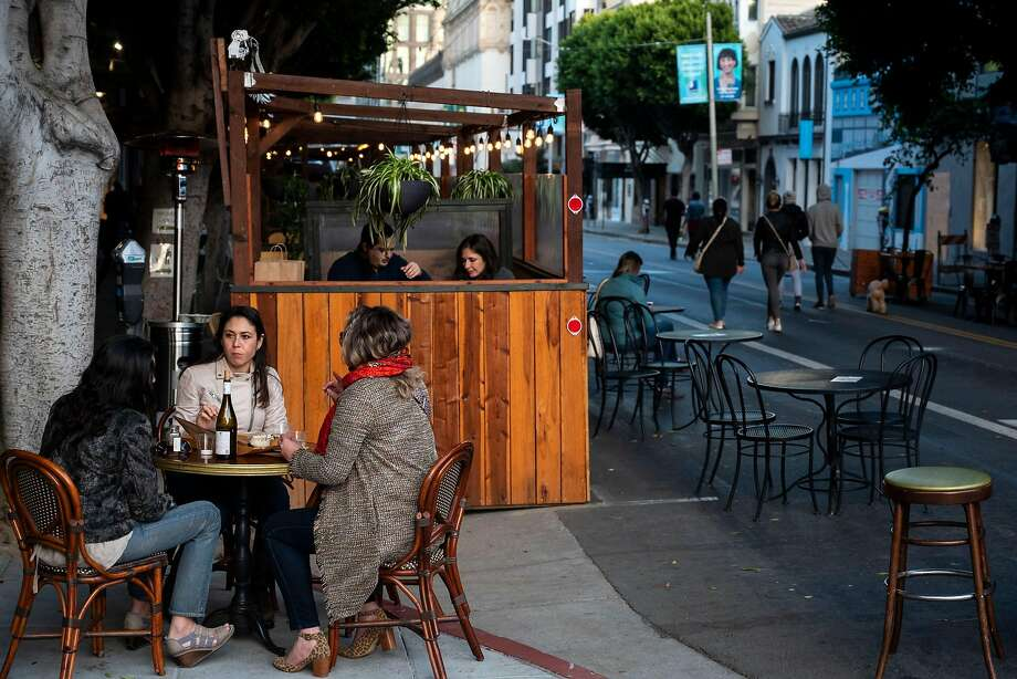 Dining outside at Absinthe, at the corner of Hayes and Gough streets in San Francisco. Photo: Josie Norris / Special To The Chronicle 2020