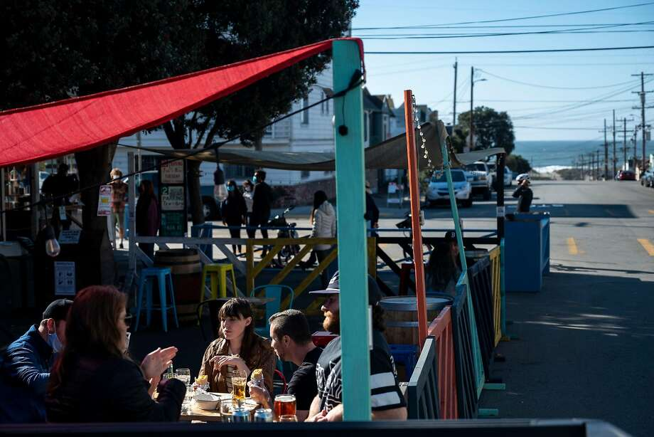 The Seven Stills distillery and Andytown coffee cafe in the Outer Sunset both have colorful parklets. Photo: Josie Norris / Special To The Chronicle