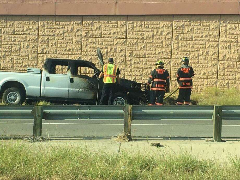 Laredo Fire Department crews said this vehicle caught on fire on Wednesday afternoon. Laredo police said the incident caused temporary traffic disruption. Photo: Courtesy Photo /Melva Lavin