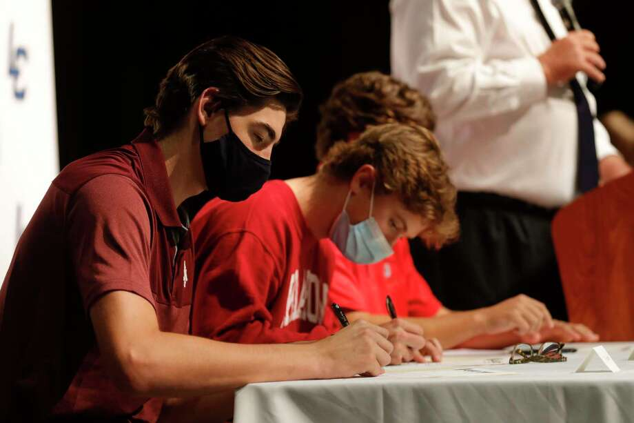 Ty Sexton, left, signed to play baseball for Texas A&M during a national signing day ceremony at Lake Creek High School. Photo: Jason Fochtman, Houston Chronicle / Staff Photographer / 2020 © Houston Chronicle