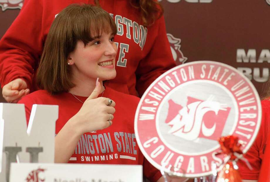 Noelle Marsh gives a thumbs-up after signing to swim for Washington State University during a national signing day ceremony at Magnolia High School, Wednesday, Nov. 11, 2020, in Magnolia. Photo: Jason Fochtman, Houston Chronicle / Staff Photographer / 2020 © Houston Chronicle