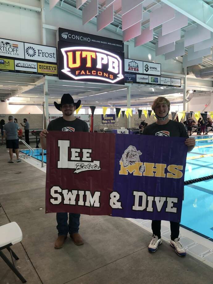 Lee's Erik Eikenbary, left, and Midland High's Legend Jankowskihold up a banner after both signed to swim for UT-Permian Basin during a ceremony, Nov. 11 at COM Aquatics. Photo: Photo Courtesy Midland ISD Swim & Dive Team