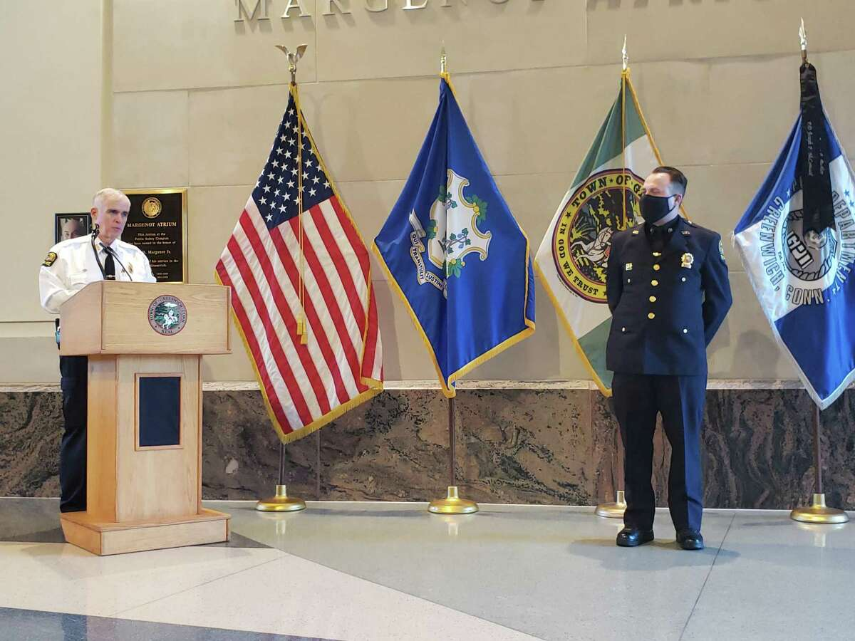 Sgt. Daniel Bucci receives a promotion from Police Chief James Heavey.