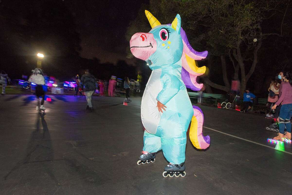 Jenem Martin roller skates in a puffy unicorn costume at Skatin' Place.