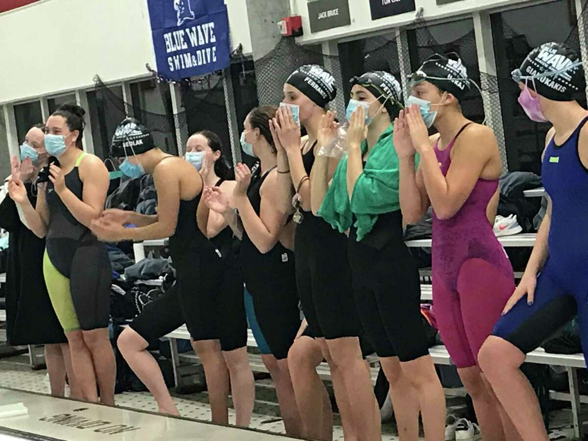 Members of the Darien swimming team cheer on their teammates during the FCIAC West Region Championships, which was held Wednesday, November 11, 2020, at Greenwich High School in Greenwich, Connecticut.