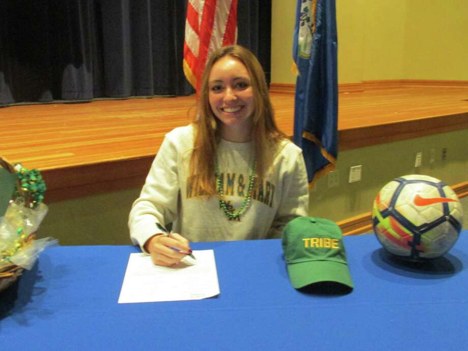 Lewis Mills soccer star Abby Mills played through a challenging season to a Division-I signing with William and Mary College Wednesday morning at Lewis Mills High School in Burlington. Photo: Peter Wallace / For Hearst Connecticut Media / Stamford Advocate Freelance