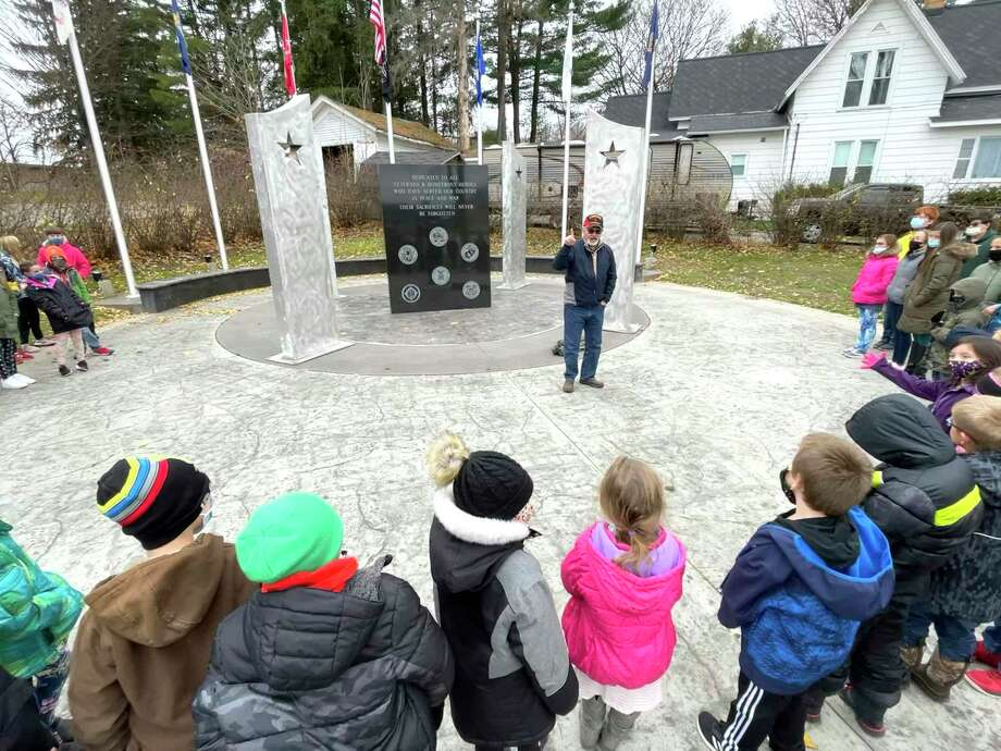 United States Army veteran John Bookshaw spoke with St. Peter's Lutheran School students Wednesday afternoon at the Veterans & Homefront Heroes Memorial at Holland Park in Big Rapids. Bookshaw, a retired pastor at St. Peter's Lutheran Church, shared his experience serving as a Captain and Chaplin in the military and the importance of Veterans Day. (Pioneer photo/Bradley Massman)