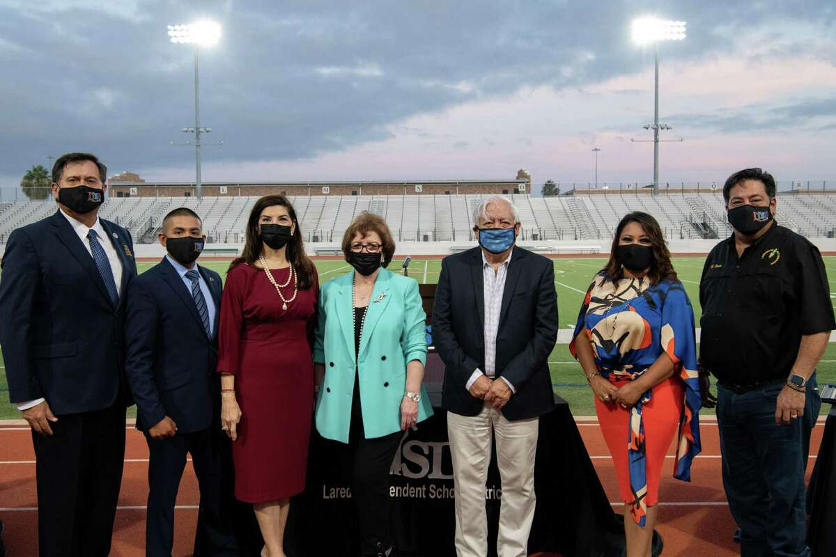 Ricardo 'Rick' Garza, Guadalupe 'Lupillo' Gomez, Dr. Minita Ramirez, Dr. Sylvia G. Rios, Hector Noyola, Monica Garcia and Hector J. Garcia pose for a photo after the new and reelected LISD board members are sworn in.