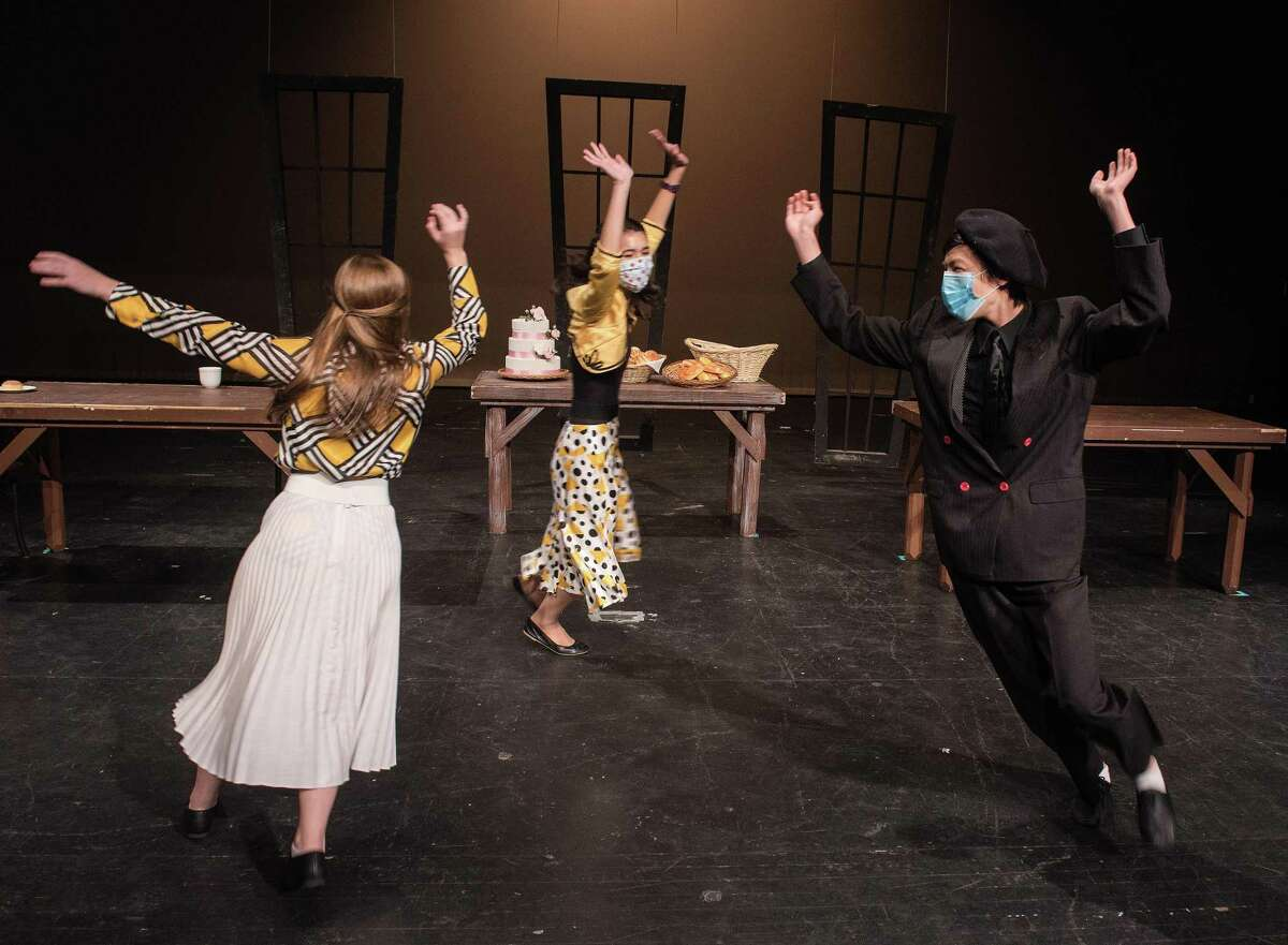 """Emmy Baer, Aki Lasher, Matthew Huang perform in Wilton High School Theatre's production of """"All in the Timing"""" this past academic school year, in Wilton, Connecticut. Students in the production have received award nominations for the production."""