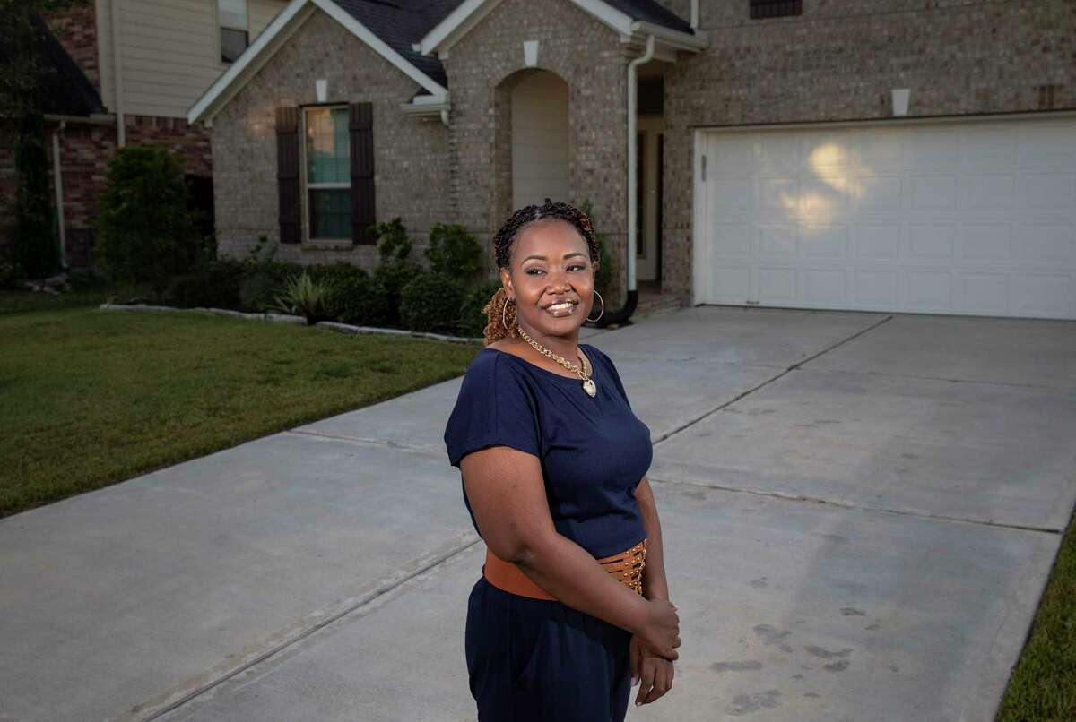 Angel Tillman poses for a portrait Friday, Nov. 6, 2020, at her home in Pearland.
