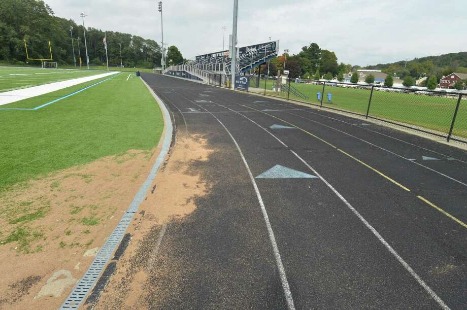 The running track at Wilton High School on Tuesday, October 2, 2018, shows signs of wear and deterioration. The Board of Finance voted on Tuesday, November 10, 2020 to authorize bonding up to $1,225,000 to replace the track with one that meets International Amateur Athletic Foundation standards. Photo: Alex Von Kleydorff / Hearst Connecticut Media / Norwalk Hour