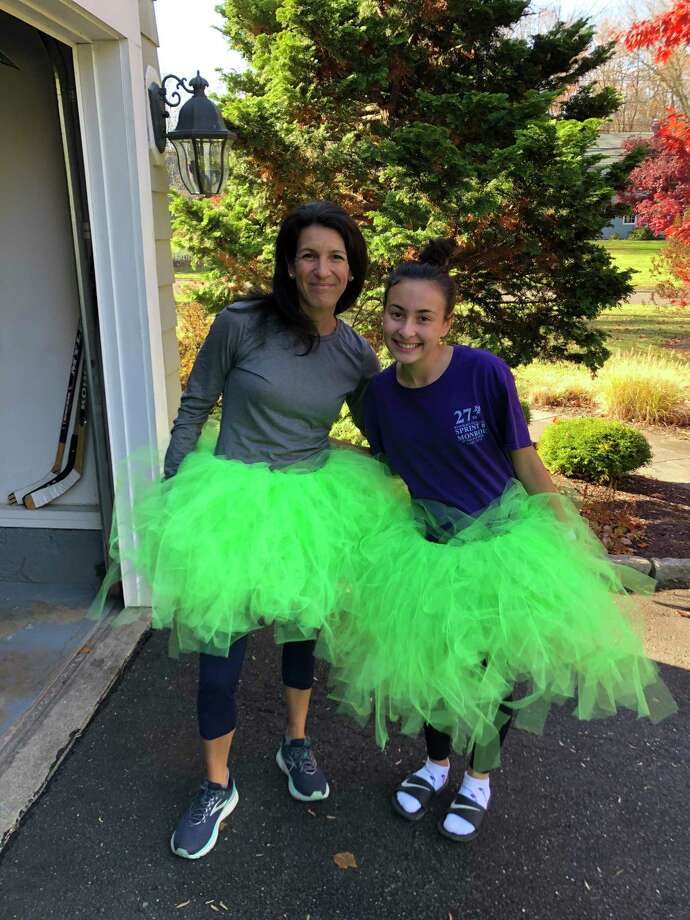 Mari and Brianna Jackson removed 24 pounds of trash from Tashua Knolls in style during the Nov. 8 town-wide virtual cleanup hosted by Sustainable Trumbull and Save the Sound. Photo: Contributed /