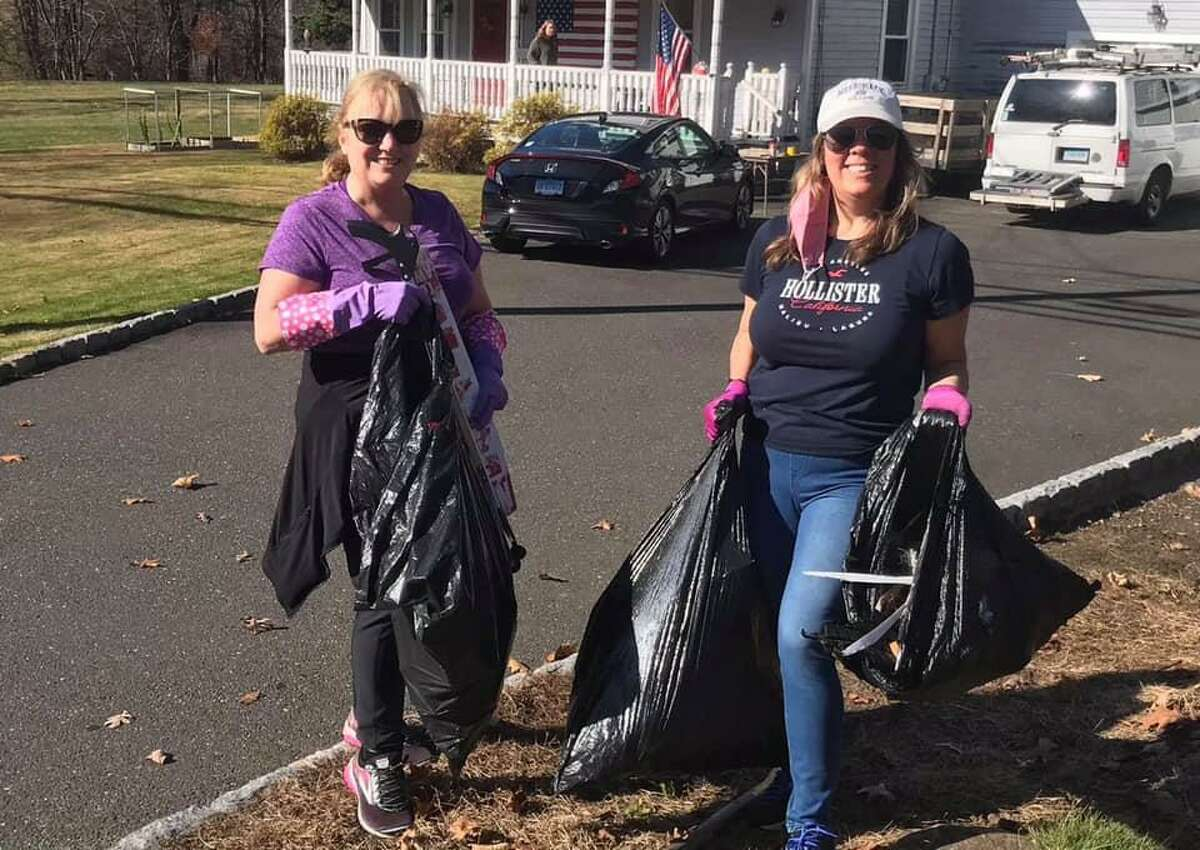 Cindy Nieburh and Julie Howes show off some of the 25 pounds of trash they collected during the Sustainable Trumbull and Save the Sound virtual community cleanup Nov. 8.