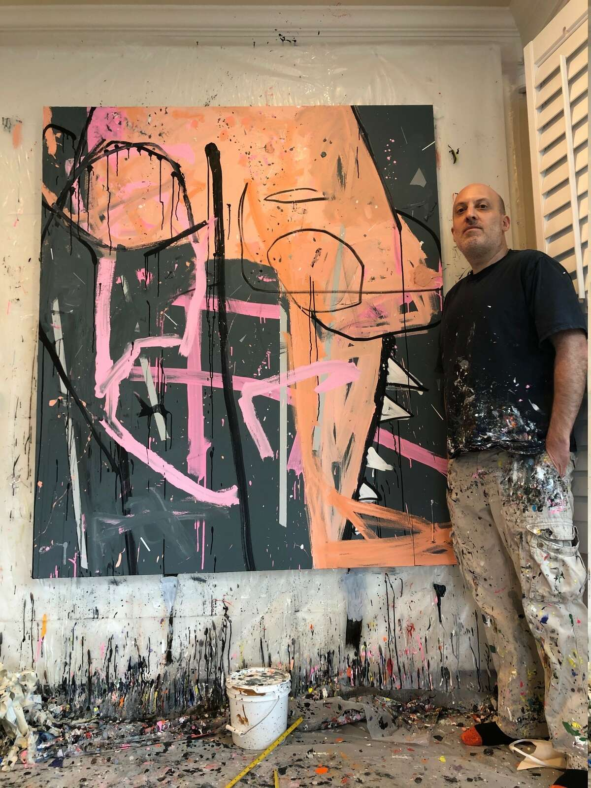 Sherman, pictured with an art piece at his studio.
