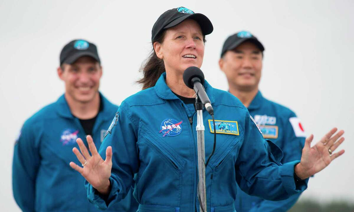 NASA astronaut Shannon Walker speaks to members of the media after arriving at NASA's Kennedy Space Center with fellow NASA astronauts Mike Hopkins and Victor Glover and Japan Aerospace Exploration Agency astronaut Soichi Noguchi on Nov. 8, 2020, in Florida.