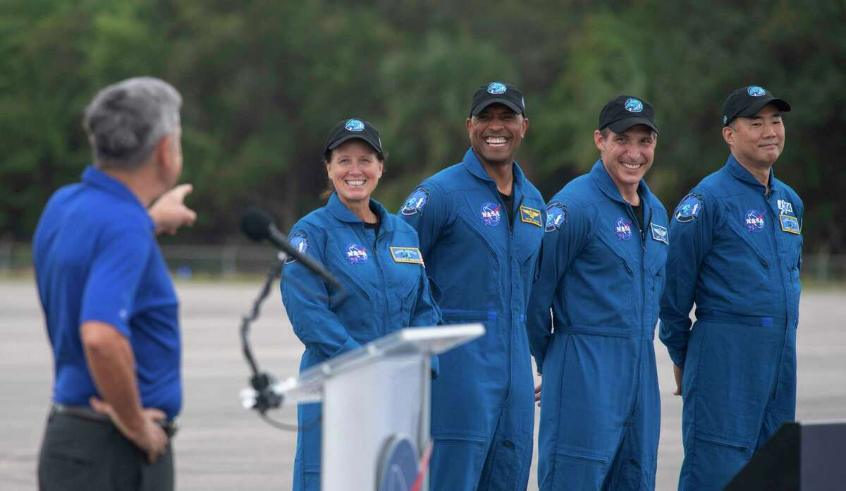 Kennedy Space Center Director Bob Cabana (left) introduces NASA astronauts (left to right) Shannon Walker, Victor Glover, Mike Hopkins and Japan Aerospace Exploration Agency astronaut Soichi Noguchi during a news conference after they arrived at the Kennedy Space Center, Sunday, Nov. 8, 2020, in Cape Canaveral, Fla.