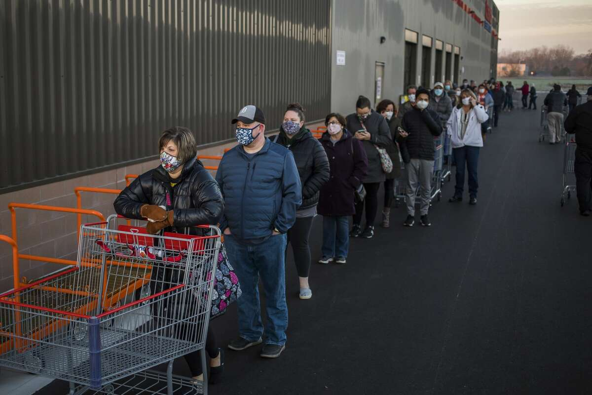 Pamela Skutt of Midland, left, pushes a cart as she waits in line to enter the new Costco during its grand opening Thursday, Nov. 12, 2020 at 4816 Bay City Rd. in Midland. (Katy Kildee/kkildee@mdn.net)