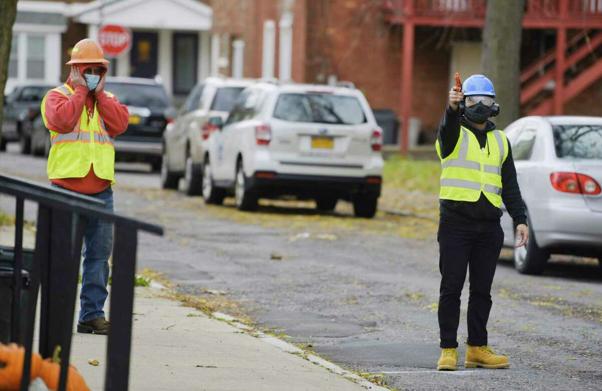 Ricky Rios, right, a technical sales engineer with Sound Intelligence, fires off blanks as he took part in a test of a gun shot detection system on Jefferson Street on Thursday, Nov. 12, 2020, in Schenectady, N.Y. (Paul Buckowski/Times Union)