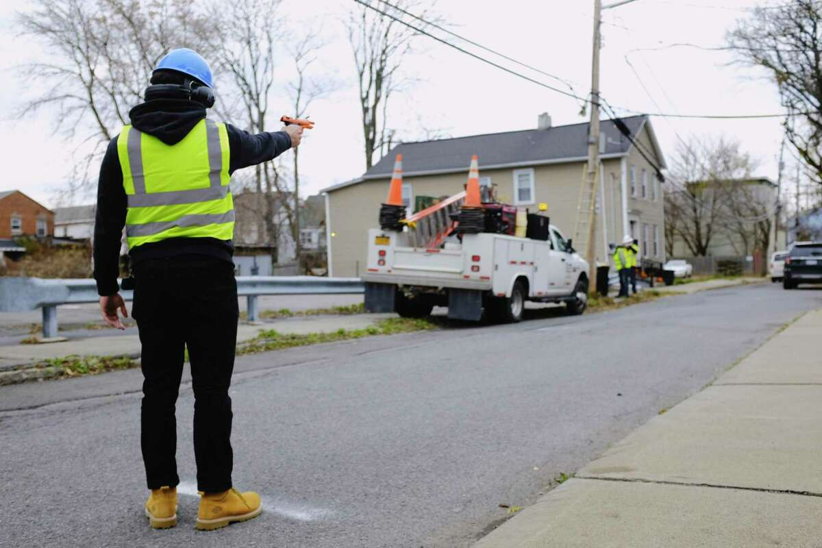 Ricky Rios, a technical sales engineer with Sound Intelligence, fires off blanks as he took part in a test of a gun shot detection system on Jefferson Street on Thursday, Nov. 12, 2020, in Schenectady, N.Y. (Paul Buckowski/Times Union)