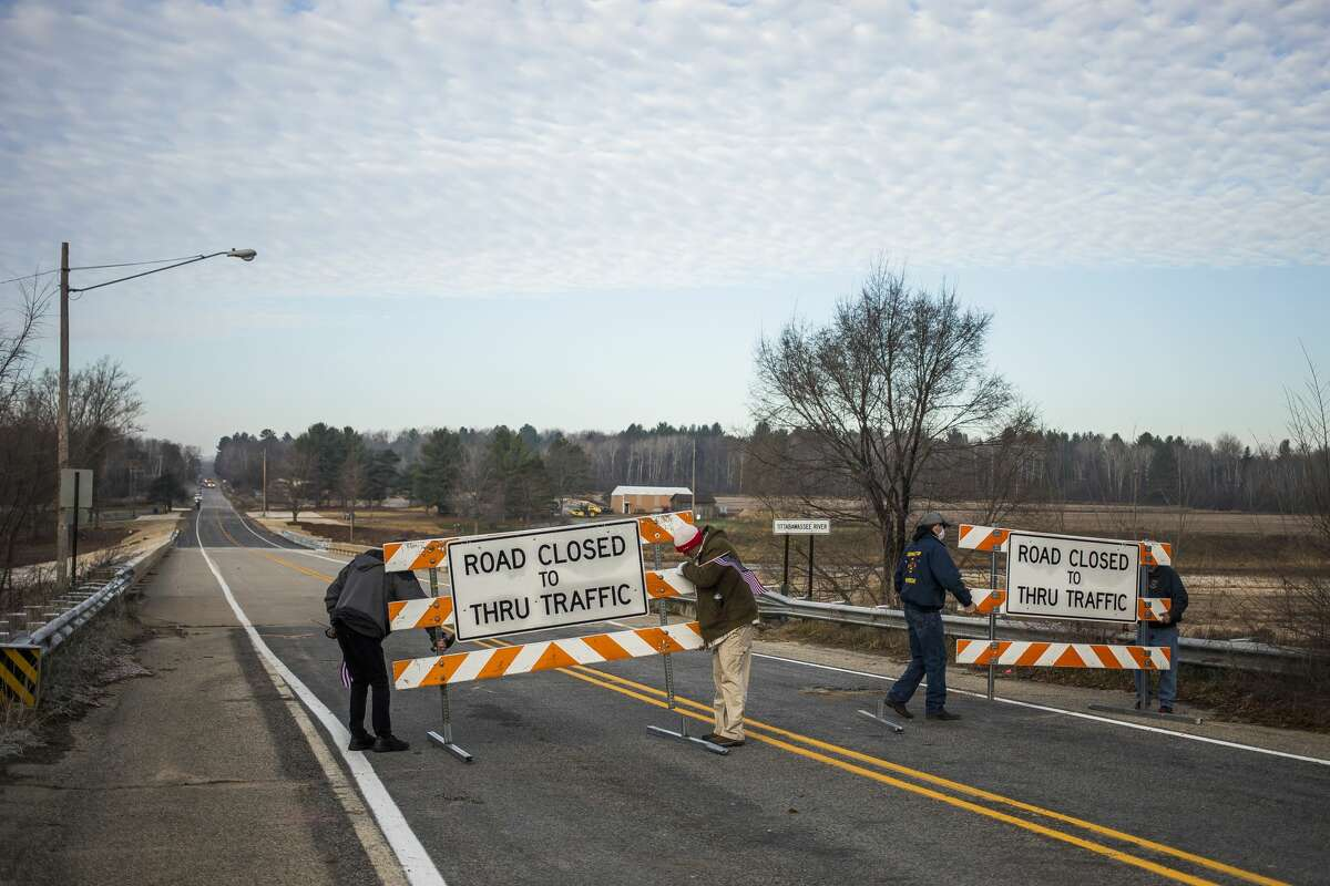 The Edenville Township Fire Department is joined by residents and community leaders as they cross the newly built Curtis Road bridge, as it is reopened to traffic for the first time since the flood, Thursday, Nov. 12, 2020 in Edenville. (Katy Kildee/kkildee@mdn.net)