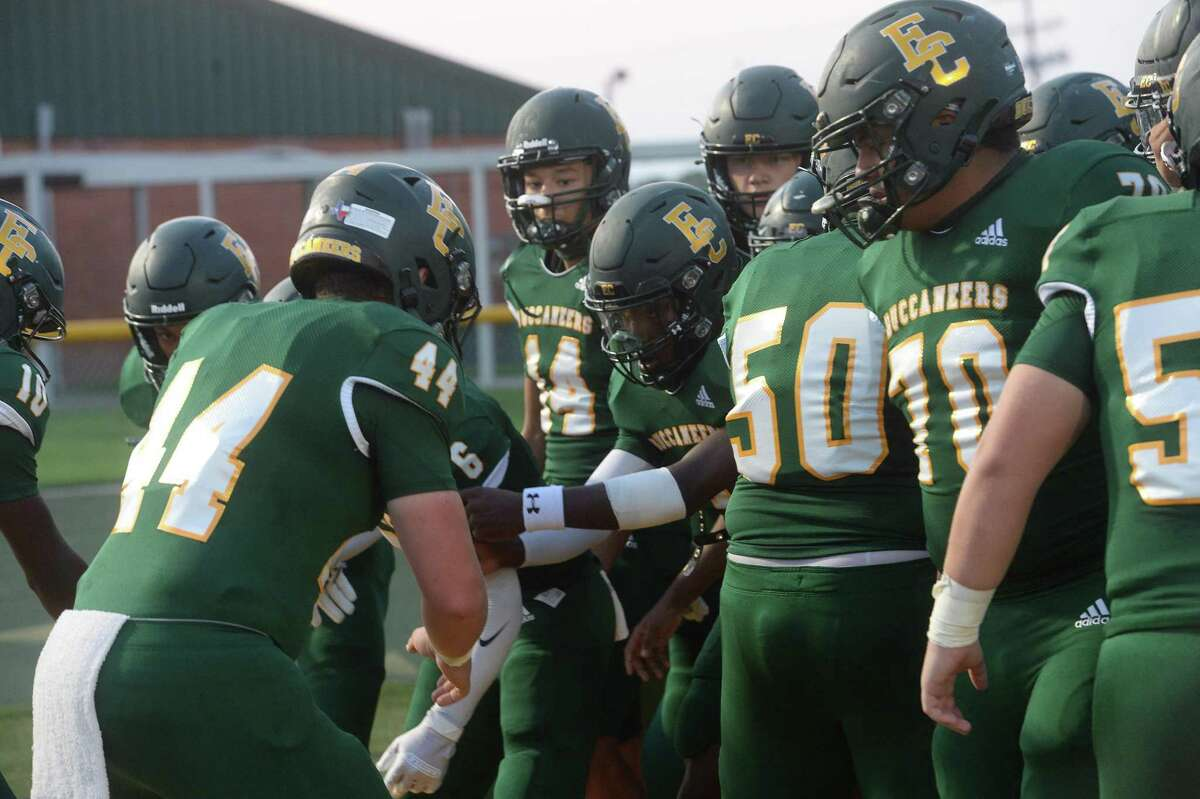 East Chambers' Buccaneers get pumped as they enter the stadium to take on Hamshire-Fannett for the Rice Bowl win Friday night in Winnie. Photo taken Friday, September 11, 2020 Kim Brent/The Enterprise