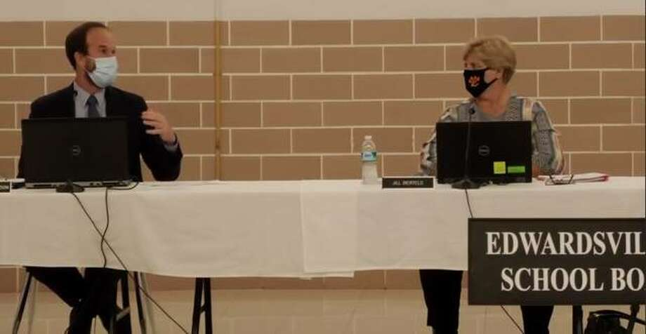 Left to right, Edwardsville School District Superintendent Jason Henderson talks about COVID-19 cases within the district as School Board of Education president Jill Bertels listens Monday night. Photo: Screengrab Of City Of Edwardsville's Facebook Livestream