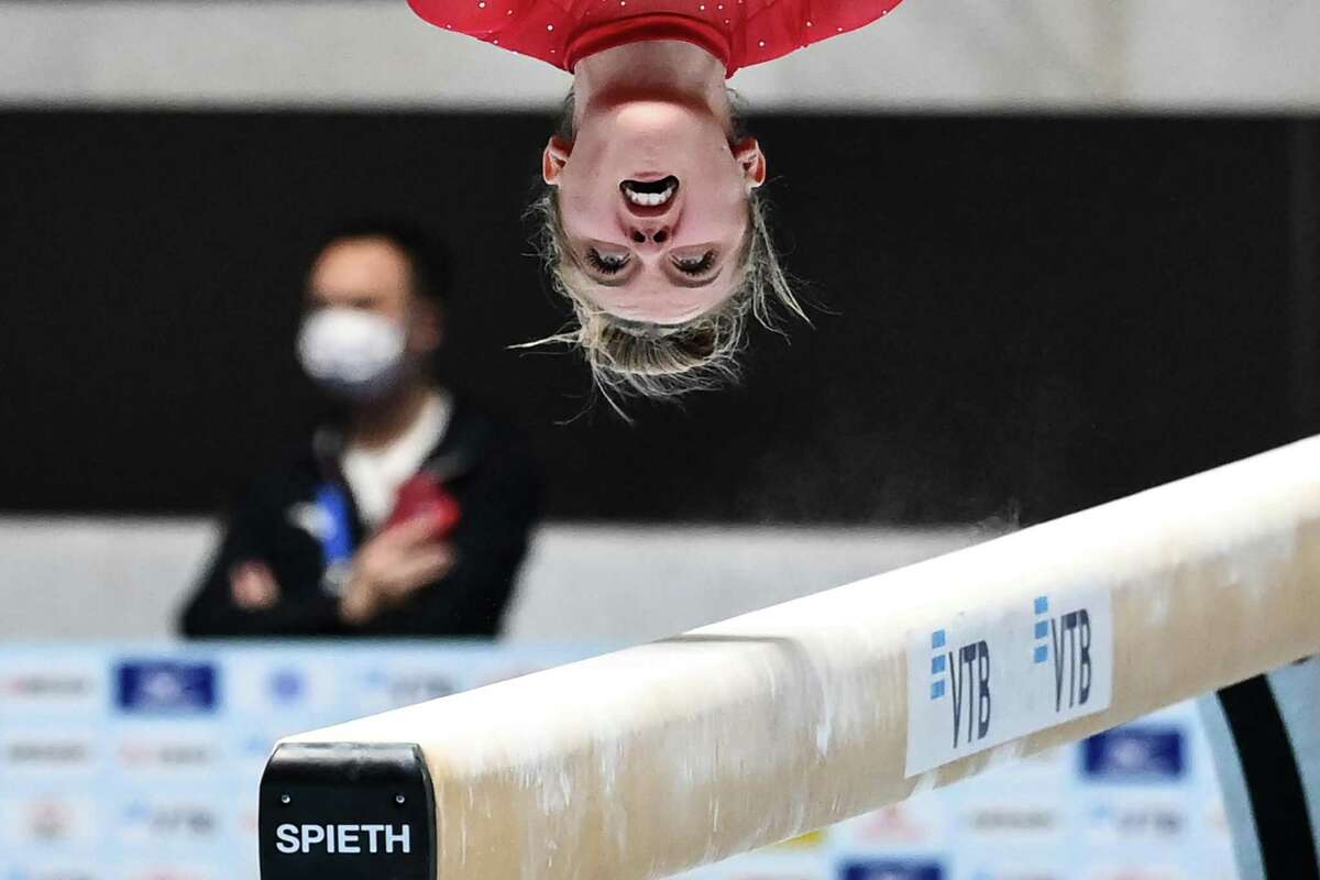 Houston's Sophia Butler performs on the balance beam during the Friendship and Solidarity Competition gymnastics event in Tokyo on November 8, 2020, the first major international sporting event in the Japanese capital since the Tokyo 2020 Olympic Games was postponed due to the coronavirus pandemic.