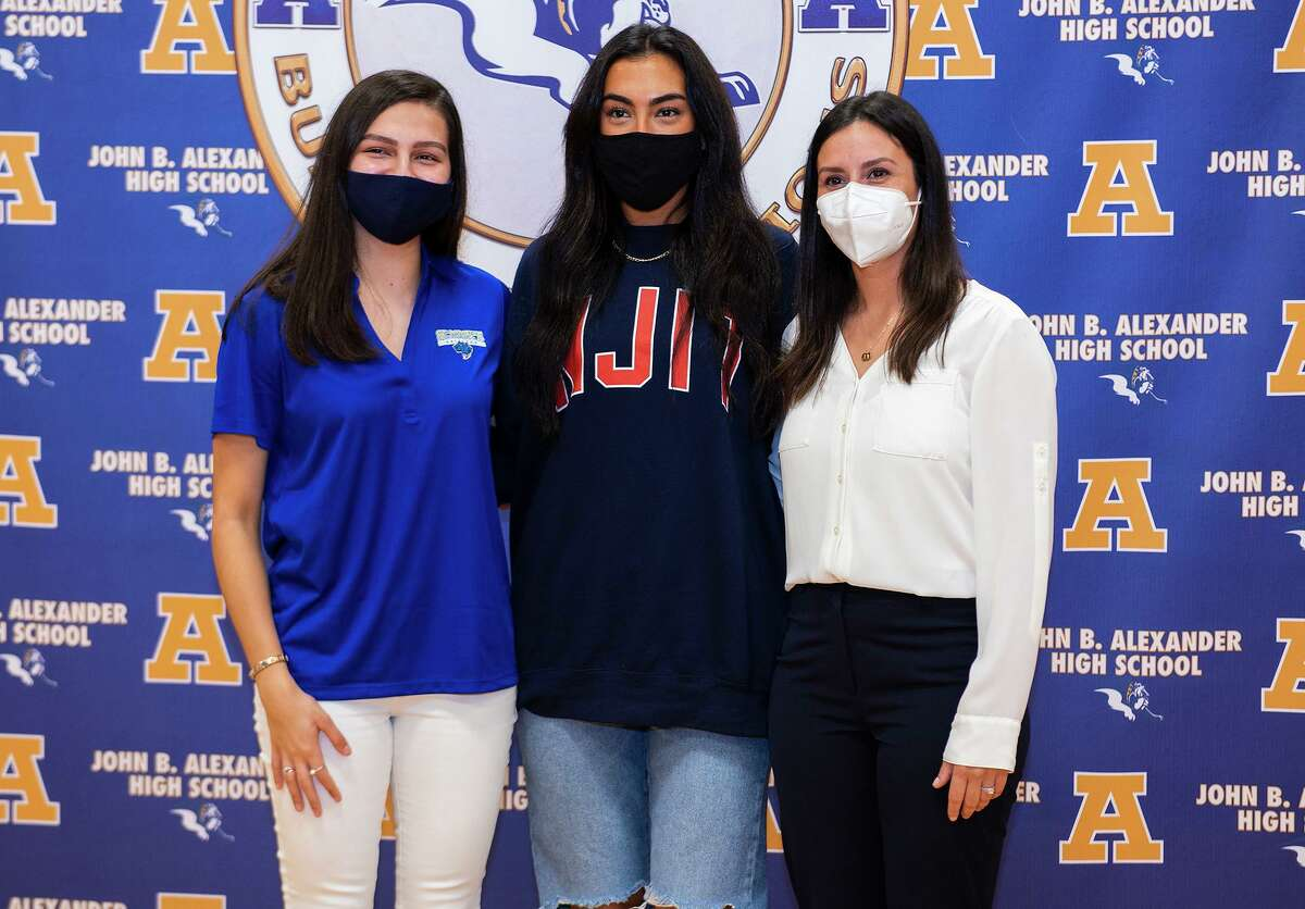Alexander High School volleyball players Leah Cruz, Asher Vallone and Coach Ariana Bermea-Mendoza pose for photos, Wednesday, Nov. 11, 2020, at Alexander High School after Cruz and Vallone signed to play college volleyball with St. Mary's University and New Jersey Institute of Technology.