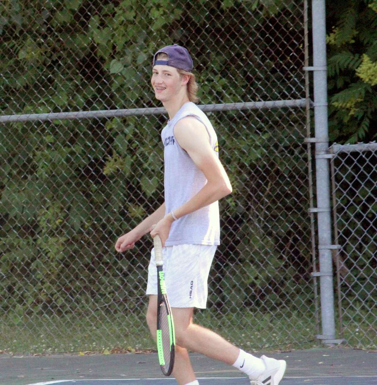 Spencer Olen, the lone senior on the Big Rapids tennis team, finishes his Cardinal career with 65 total wins. (Pioneer photo/John Raffel)