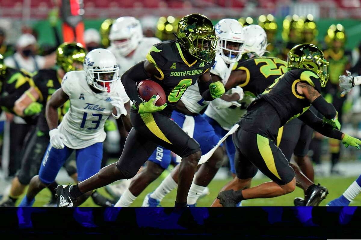 South Florida defensive back Daquan Evans (0) runs with the football after intercepting a pass by Tulsa quarterback Zach Smith during the first half of an NCAA college football game Friday, Oct. 23, 2020, in Tampa, Fla. (AP Photo/Chris O'Meara)