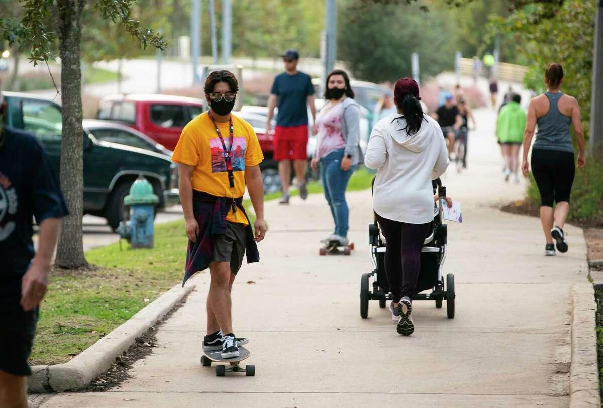 People use the path, Tuesday, Nov. 10, 2020, at Buffalo Bayou Park in Houston.