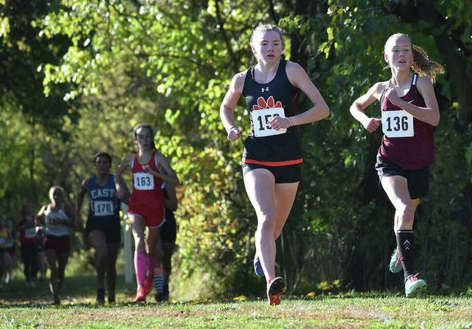 Edwardsville sophomore Riley Knoyle, front left, comes out of the woods during the Class 3A Normal Community Sectional on Oct. 31 in Maxwell Park in Normal.