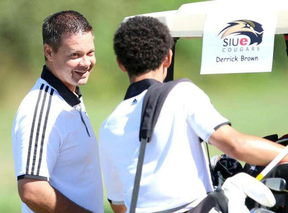 SIUE head golf coach Derrick Brown talks with Cougar Conor Dore during a previous season. Photo: SIUE Athletics