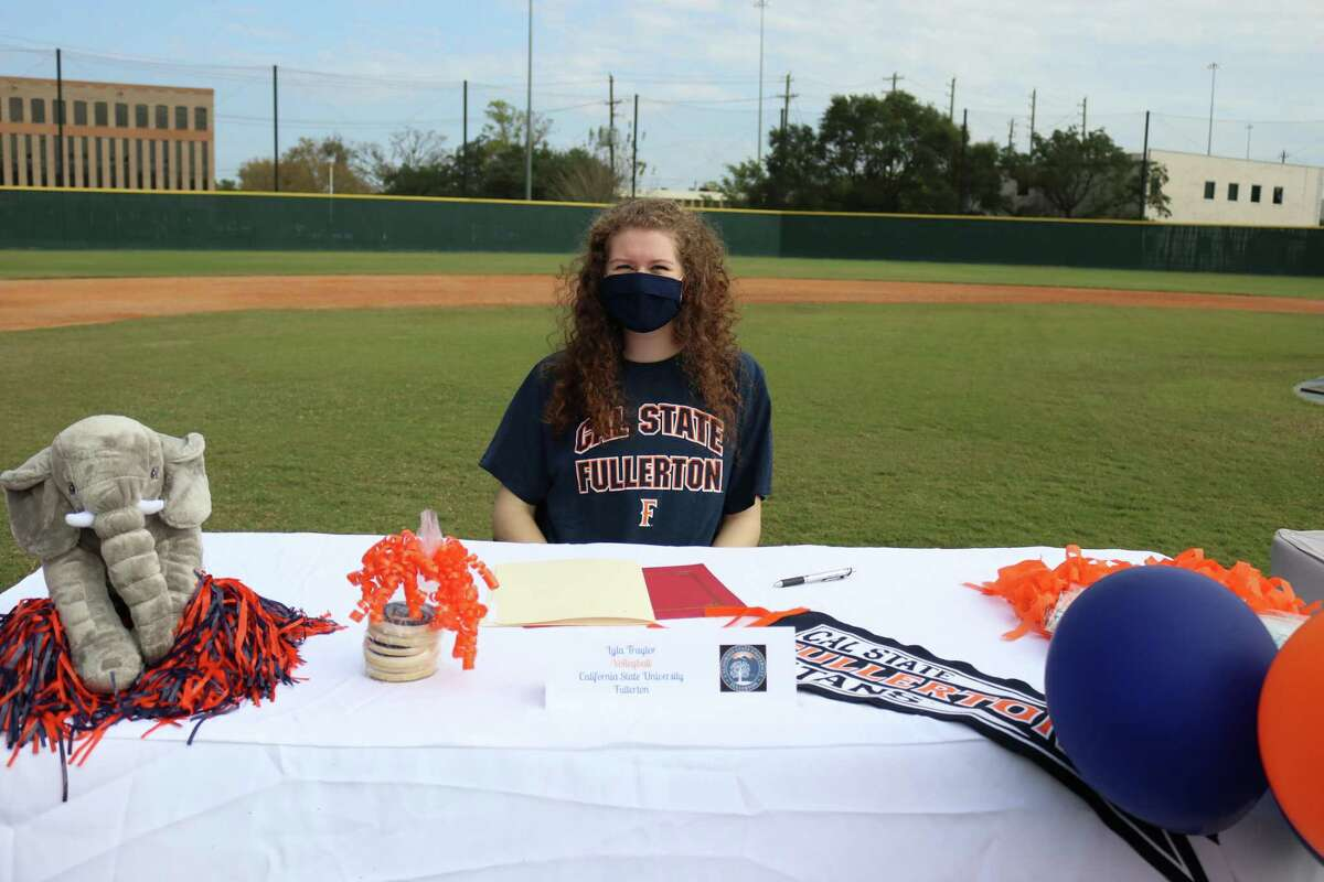 Memorial's Lyla Traylor signed her National Letter of Intent to play volleyball at Cal State Fullerton at the school's Early Signing Day ceremony on the morning of Nov. 11