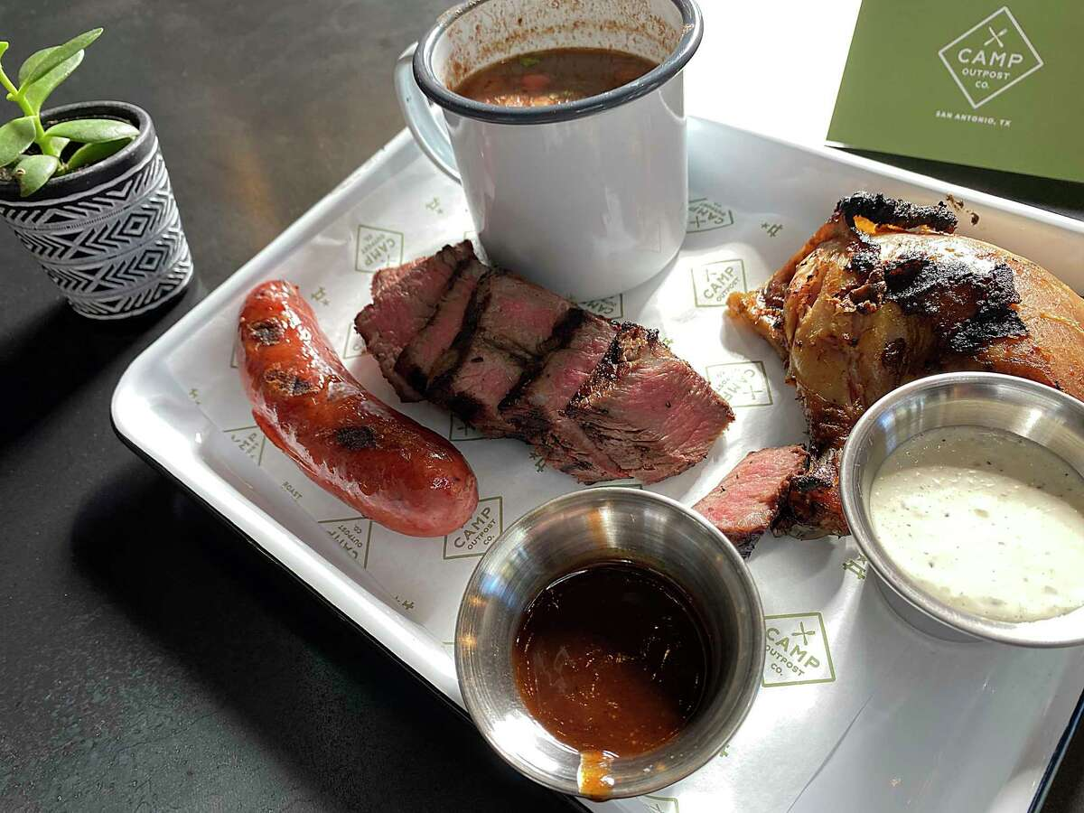 The Camp All-Natural Meat Plate includes rotisserie chicken, tri-tip steak, grilled sausage and charro beans at Camp Outpost Co., a new venture from the Piatti family of restaurants.