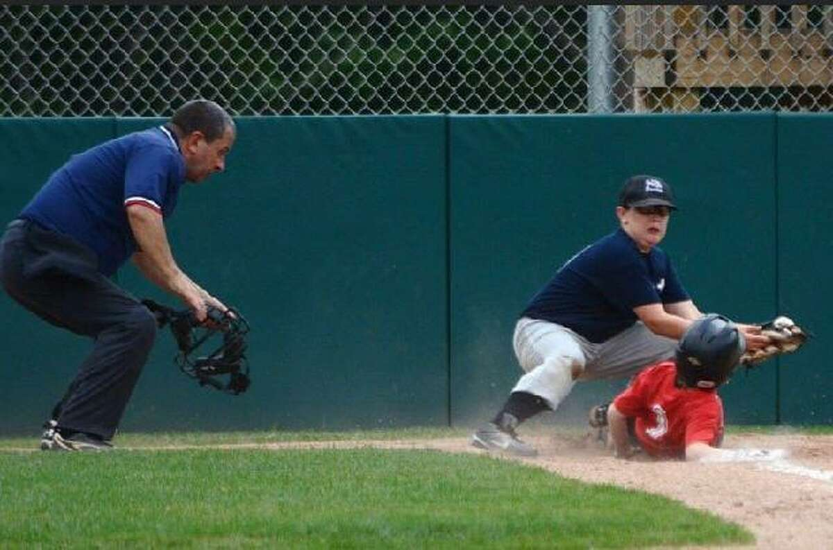 """Beloved North Branford, Conn. Little League baseball umpire, the late Lewis """"Lou"""" Paternoster, at a July 2014 game as third baseman Aiden Cole catches the ball. Photo provided by Aiden Cole's father, Gary Cole. Not your average umpire Lou Paternoster grew up in the Trumbull area and attended Trumbull High School, according to Betty Jo Paternoster. The couple moved to North Branford in the 1980s, after marrying and living for a few months in Virginia, where they met on a business trip, she said. Over the years, Lou Paternoster coached various sports teams, served on athletic boards, umpired baseball games and refereed basketball games. But he wasn't your average volunteer. State Rep. Vincent Candelora, who represents North Branford in the state legislature and knew Paternoster through coaching, said he had a knack for making every kid feel special. """"The one thing about Lou - he's great with kids,"""" Candelora said. """"This death is going to affect kids as much as adults."""" Mascari, who knew Paternoster through sports, remembered one basketball game Paternoster refereed where he kept calling fouls on one team so that a struggling player on the other could make free throws. """"[Lou] would always give a kid a break and always try to make a kid, you know, feel good about himself,"""" he said."""