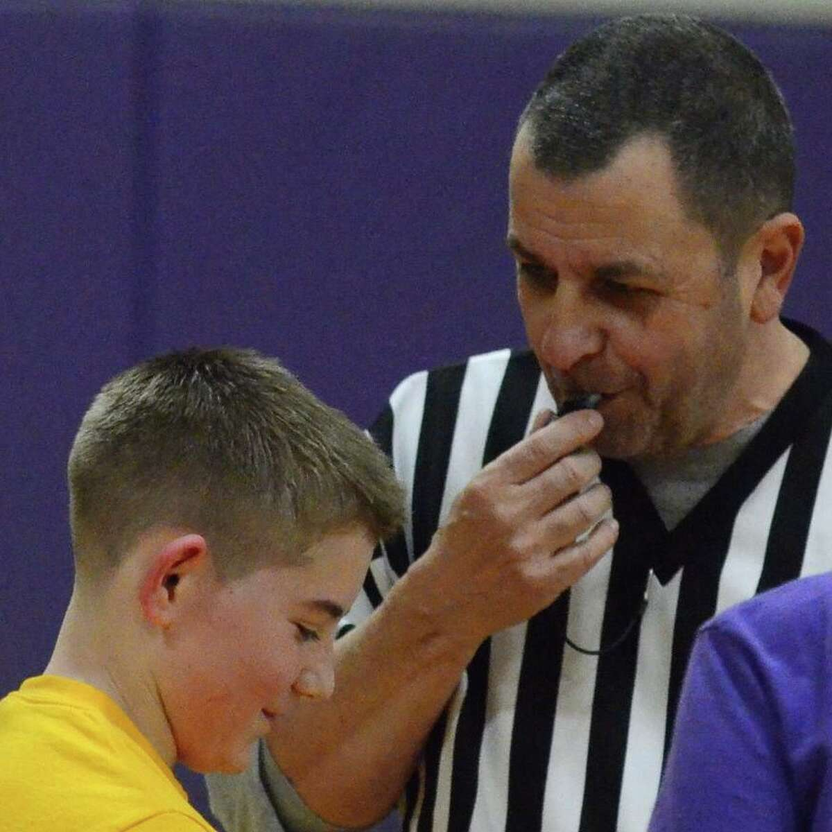 """Lewis """"Lou"""" Paternoster, who served as a referee in North Branford, Conn., stands with Matthew Vitkovsky during a 2014 basketball game. """"I could tell by the look on both of their faces Lou had just finished telling Matthew something funny,"""" Matthew's mom, Maureen Vitkovsky, said. """"No matter what happened, what you needed ... he would always be there to help pick up the pieces and help get everybody back on their feet again,"""" Betty Jo Paternoster, his wife of 36 years, said. """"If he wasn't right there, he was gonna be there as soon as possible"""" But Nov. 4, the day Lou Paternoster suffered a stroke, was probably the first time he didn't show up, she said. He died Nov. 6. But since then, Lou Paternoster's family has been inundated with messages from a community in mourning, from people who knew him through sports, or town politics, or his decades-long career in sales. It's left Betty Jo Paternoster - who might be the only person who spells his name """"Lew"""" - floored. She uses the phrase """"community Lou"""" to describe the striking public figure her late husband cut. """"I'm soakin' in all the good things that I'm hearing from other people about him, because those things mean the world,"""" she said. """"The 'community Lou' right now is shining like a golden star."""""""