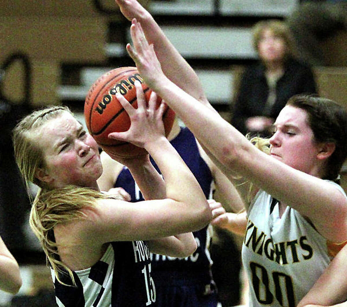 Mallory Martin of East Alton-Wood River, left, controls the ball while being guarded by a Metro-East Lutheran player last season. The Oilers girls and boys basketball teams' 2020-21 season has been cancelled for now.
