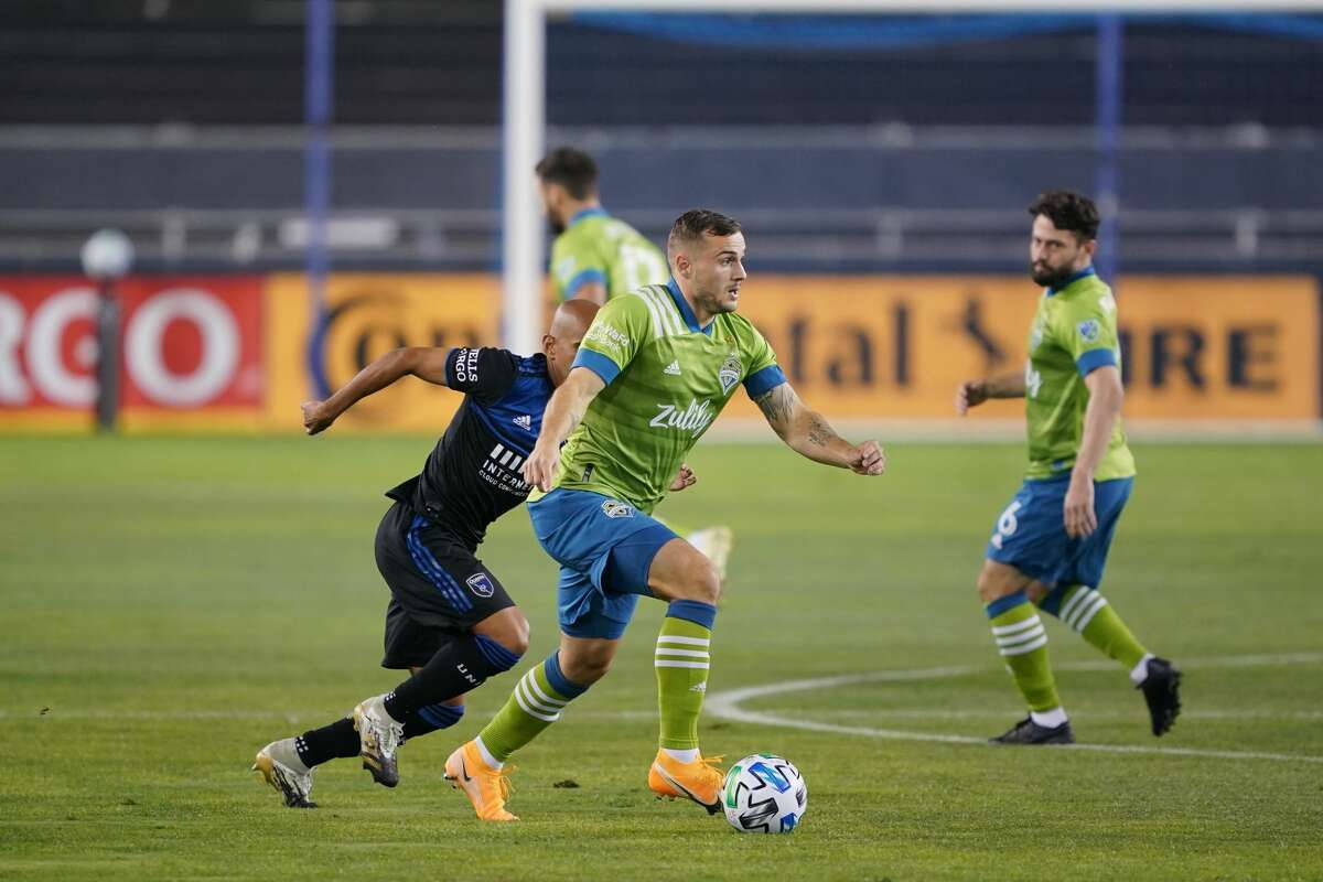 SAN JOSE, CA - OCTOBER 18: Jordan Morris #13 of the Seattle Sounders during a game between Seattle Sounders FC and San Jose Earthquakes at Earthquakes Stadium on October 18, 2020 in San Jose, California.(Photo by John Todd/ISI Photos/Getty Images).