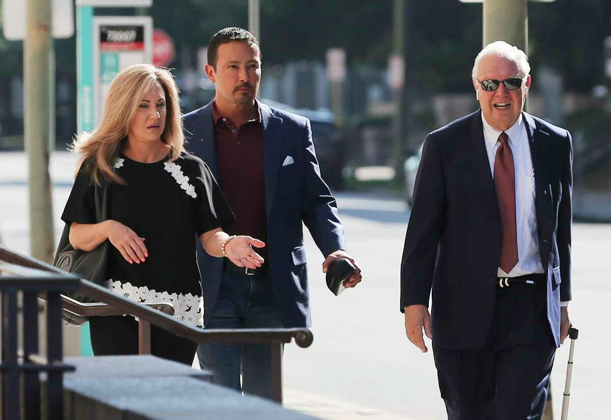 A cease-and-desist order issued against Brian Alfaro, center, and Kristi Alfaro by the Texas State Securities Board on Monday alleges they both sold interests in exotic wildlife venture to six investors - all over the age of 70. The Alfaros walk with attorney Dean Green to U.S. Bankruptcy Court in 2019.