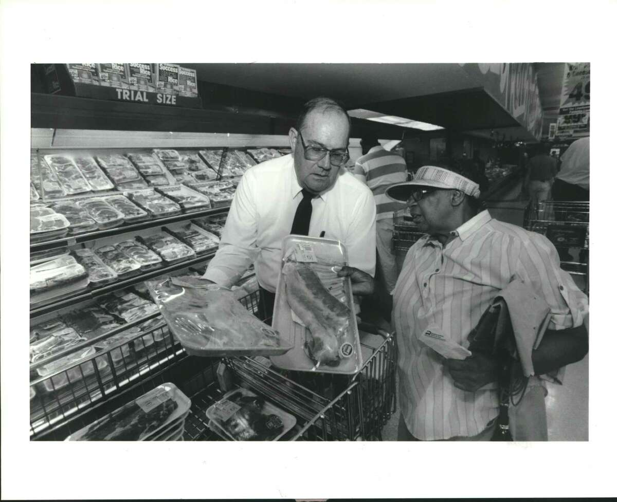 Gene Fanker, left, advertising manager for Kroger Co.'s Houston marketing area, talks with a customer at the Montrose store.