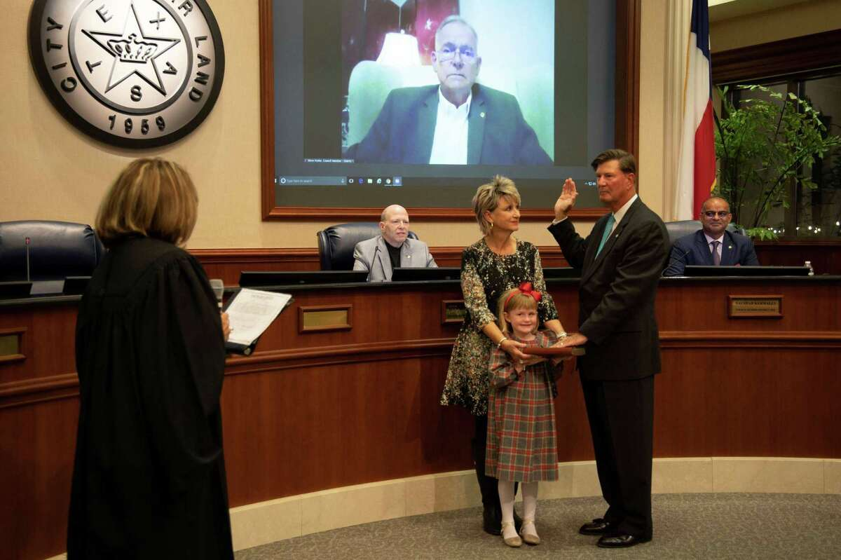 Joe Zimmerman was sworn in for his third term as Sugar Land mayor by Texas Supreme Court Justice Eva Guzman, left.